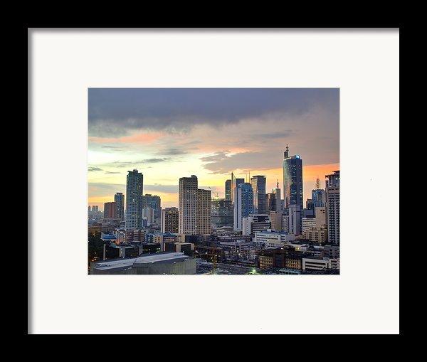 Sunset Over  Makati City, Manila Framed Print By Neil Howard