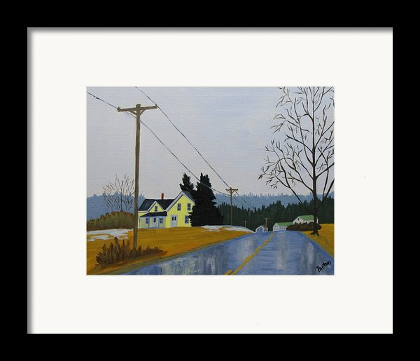 Yellow House In March Framed Print By Laurie Breton